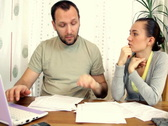 Stock Video Footage of A young couple overwhelmed by bills