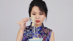 Beautiful Chinese Woman Eating Noodles With Chopsticks Stock Footage