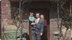 Young familiy leaving house (vintage 8 mm amateur film) Stock Footage