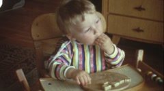 Toddler eating bread (vintage 8 mm amateur film) Stock Footage