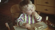 Stock Video Footage of Toddler eating bread (vintage 8 mm amateur film)