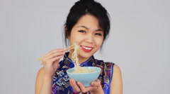 Pretty Chinese Young Woman Eating With Chopsticks Stock Footage