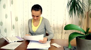 Stock Video Footage of Woman overwhelmed by bills