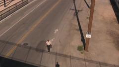 A Homeless Man Walks Under the Bridge Stock Footage