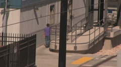 People walk up to the train station Stock Footage
