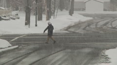 Person walks under a snow storm-Liberta0020 Stock Footage