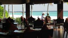Couple on restaurant beach terrace Stock Footage