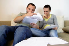 A young couple overwhelmed by bills - stock footage
