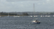 Yacht moored to a buoy turns on wind on Rutland Water. Stock Footage