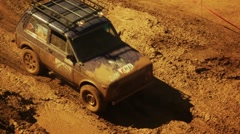 Off-road vehicle on dirty race Stock Footage