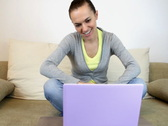 Young woman with laptop talking on videochat Stock Footage