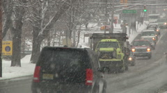 Traffic and a snow plowing truck under snow storm-Liberta0008 Stock Footage