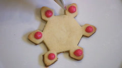 Decorating Christmas Snowflake Cookie Stock Footage