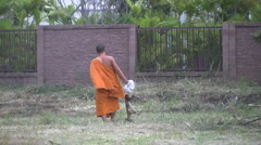 Buddhist Monk Disposing A Dead Dog Stock Footage