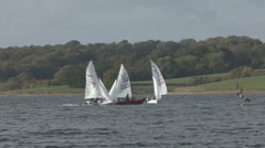 Sail training - dinghies do loops around RIB on Rutland Water. Stock Footage