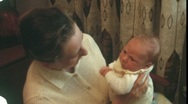 Stock Video Footage of Baby hold by mother (vintage 8 mm amateur film)