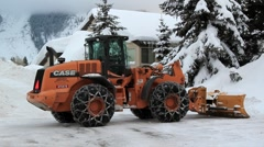 SNOWPLOW CLEARING SNOW - stock footage