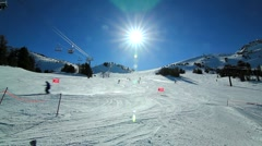 WIDE SKI RUN WITH SUN Stock Footage