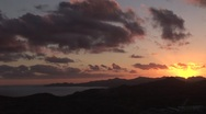 Stock Video Footage of Pastel Sunset As Clouds Move Over Bay