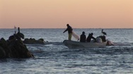 Stock Video Footage of Fishermen Casting Net In Waves Near Rocks
