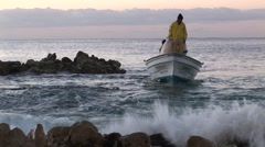Sunrise Fisherman Stands In Panga Looking For Bait Stock Footage