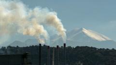 Smoke stacks and snow on mountains Stock Footage