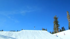 3 SNOWBOARDERS JUMP WIDE Stock Footage