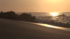 Golden Sunrise Over Beach as Waves Crash To Shore Stock Footage