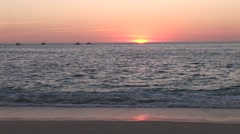 Stock Video Footage of Sunrising Over Ocean with Boats Offshore