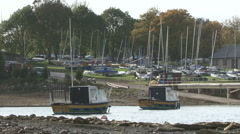 Boats moored to buoys near a marina on Rutland Water. - stock footage