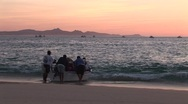 Stock Video Footage of Sunrise Fishermen Push Panga Boat Out To Sea
