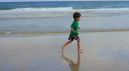 Stock Video Footage of Happy Child running on beach then falling