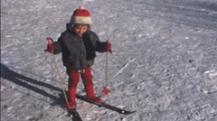 Little child on ski in the 1960s (vintage 8 mm amateur film) Stock Footage