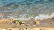 Turquoise sea water waves and stones Stock Footage