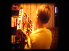 Cute Blonde boy gets Legos for christmas Stock Footage