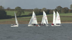 Sail training - dinghies circling RIB on Rutland Water. Stock Footage