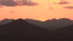 Pastel Sky & Mountain Silhouettes At Dusk Stock Footage