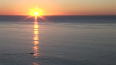 Boat Moves Through Sun Ray At Sunrise Stock Footage