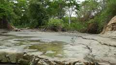 Eroding shale cliffs at the back of a tropical beach Stock Footage