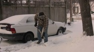 Stock Video Footage of Man shoveling snow in driveway
