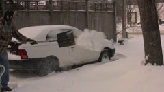 Man shoveling snow in driveway Stock Footage