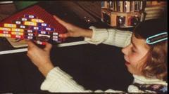 Girl opening Christmas calendar (vintage 8 mm amateur film) Stock Footage