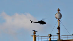 Black Helicoptor Around Ship and City Skyline Stock Footage