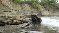 Waves breaking against rock strata Stock Footage