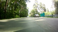 Car drive on road rear view in sunny day Stock Footage
