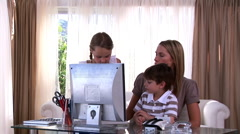 Montage of a mother taking care of her children - stock footage
