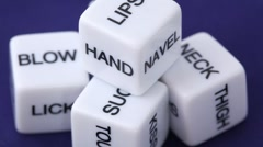 White dice with erotic messages on the sides Stock Footage