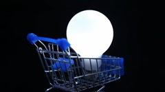 Close-up shot of white electric lamp in toy shopping trolley Stock Footage