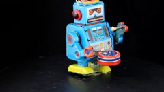 Clockwork toy robot marching with drum Stock Footage