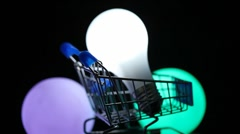 White electric lamp in toy shopping trolley rotating Stock Footage